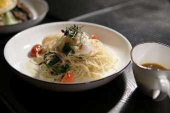 Maine Lobster and Capellini served with aromatic lobster